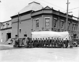 Staff of Goodale Transport Limited in front of one of their trucks